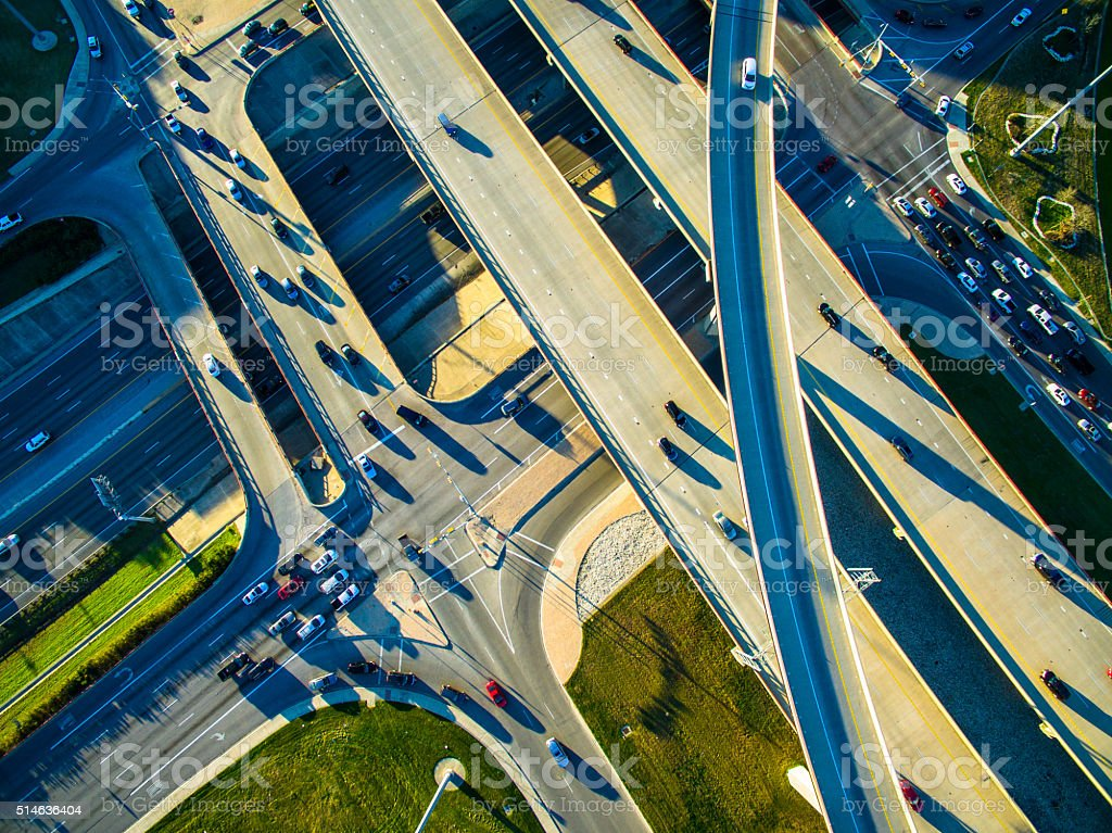 aerial high angle looking down interchange highway transportation stock photo