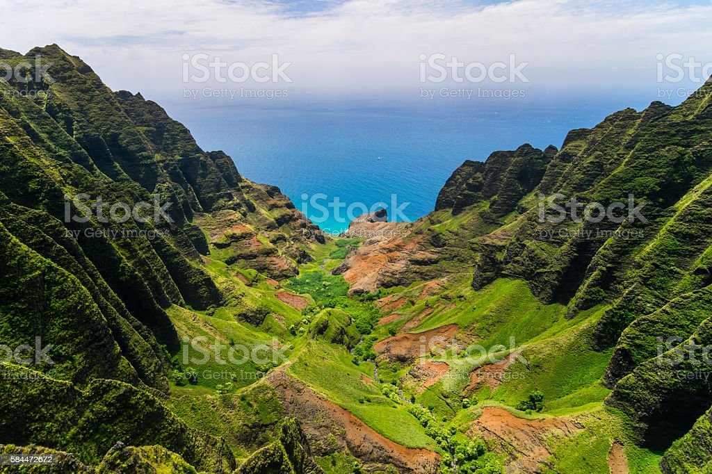 Aerial landscape view of cliffs and green valley, Kauai stock photo