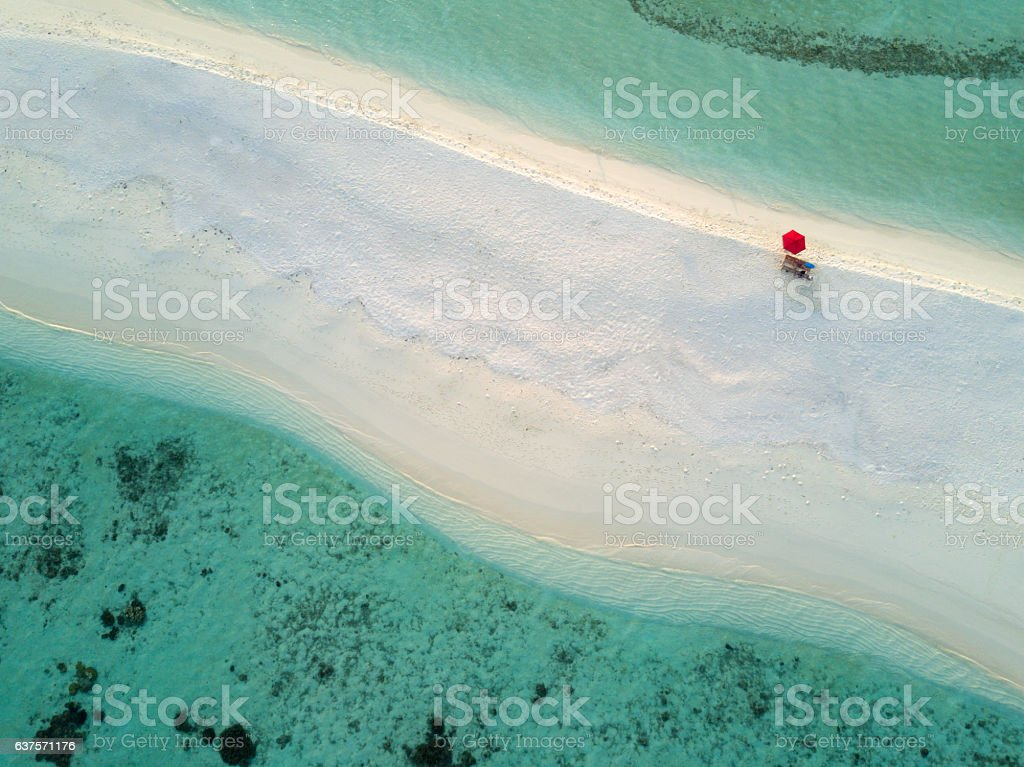Aerial Lonely Red Umbrella Beach Maldives South Ari Atoll stock photo