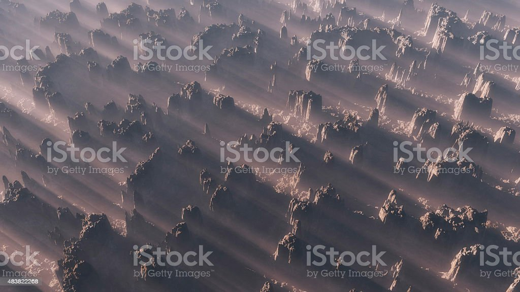 Aerial of rocky mountain range in the mist at sunrise stock photo