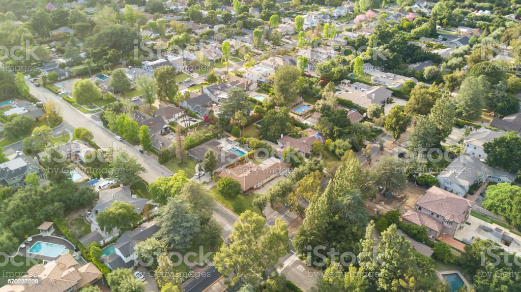 Aerial of Trees and Houses with Flare stock photo