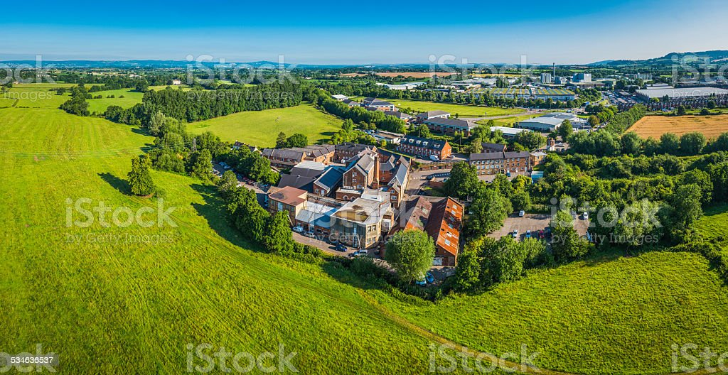 Aerial panorama across factories mills light industry in green countryside stock photo