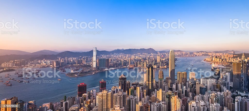 Aerial panorama of Hong Kong's Victoria harbour at sunset stock photo