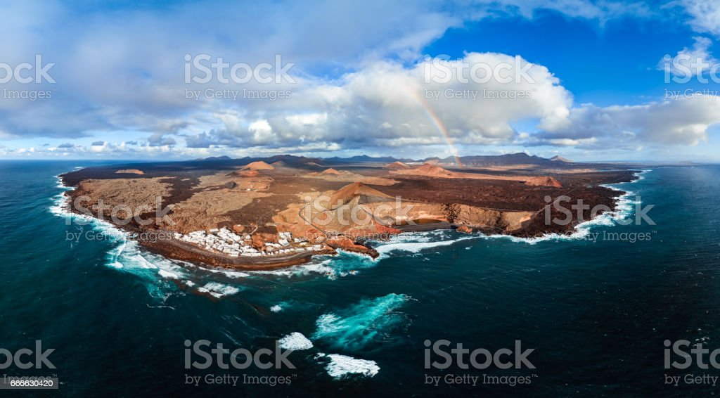Aerial panorama of Lanzarote Island and Volcanic Lake El Golfo, Canary Islands. stock photo