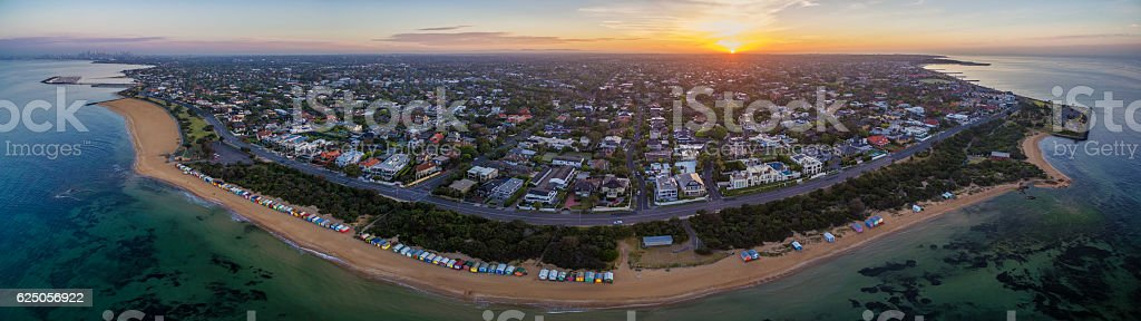Aerial panorama of sunrise over Brighton suburb, showing iconic stock photo