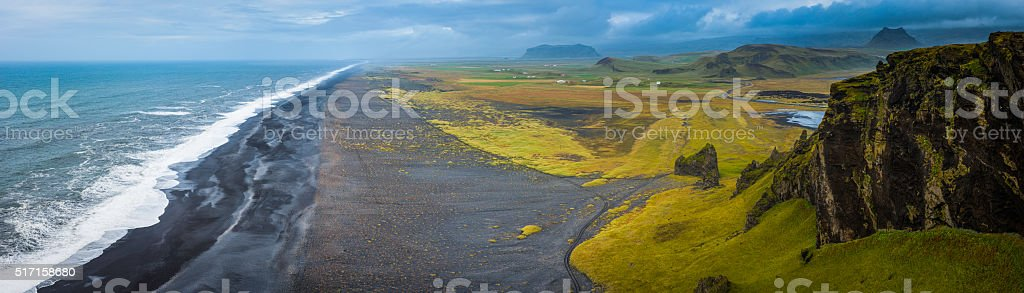 Aerial panorama over black beach wild Arctic Ocean surf Iceland stock photo