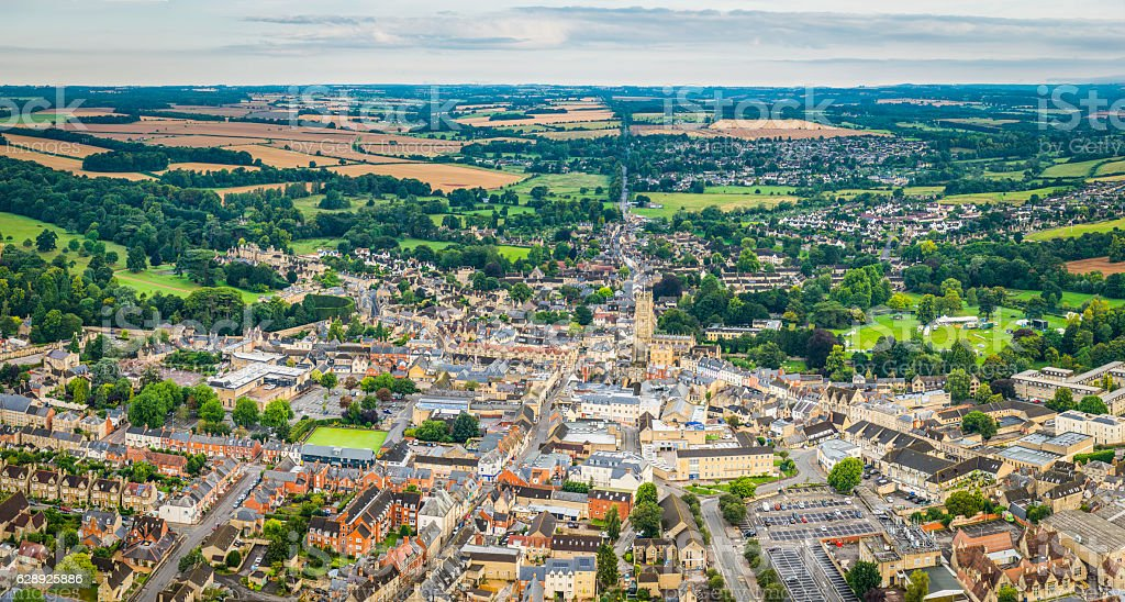 Aerial panorama over country town and homes Cirencester Cotswolds UK stock photo