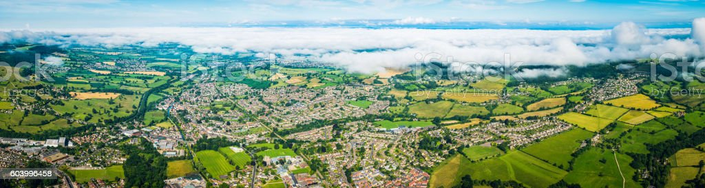 Aerial panorama over country town suburban homes patchwork fields Stroud stock photo