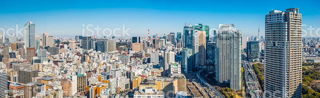 Aerial panorama over crowded cityscape highrise skyscrapers highways Tokyo Japan stock photo