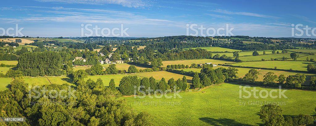 Aerial panorama over green summer pasture idyllic country villages farms stock photo