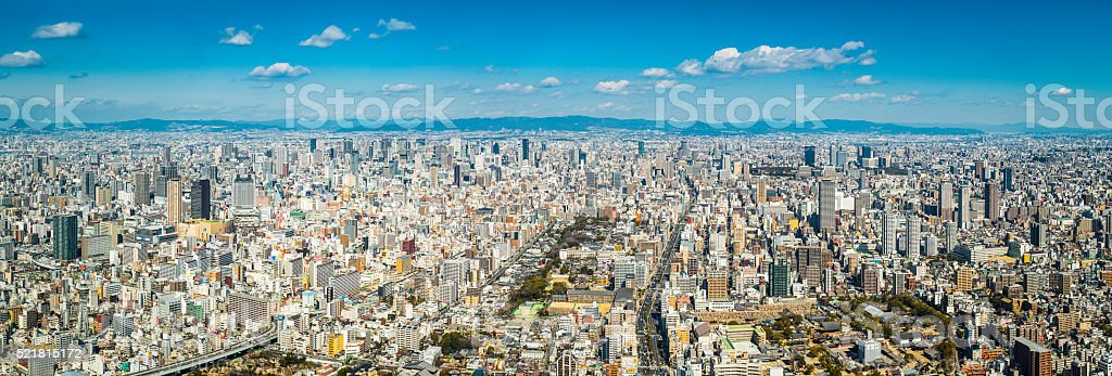 Aerial panorama over Osaka crowded cityscape skyscrapers and highways Japan stock photo