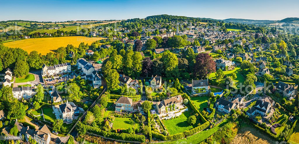 Aerial panorama over picturesque country village rural homes summer fields stock photo