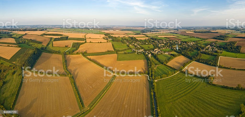 Aerial panorama over rural patchwork quilt of farms crops fields royalty-free stock photo