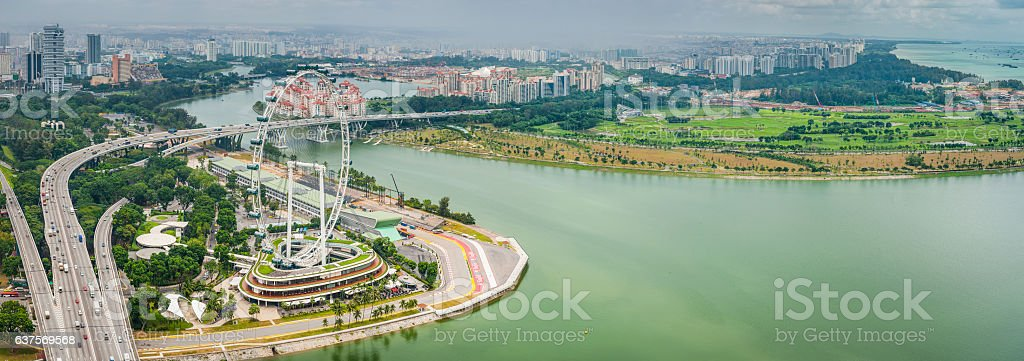 Aerial panorama over Singapore Marina Bay highways and highrises stock photo