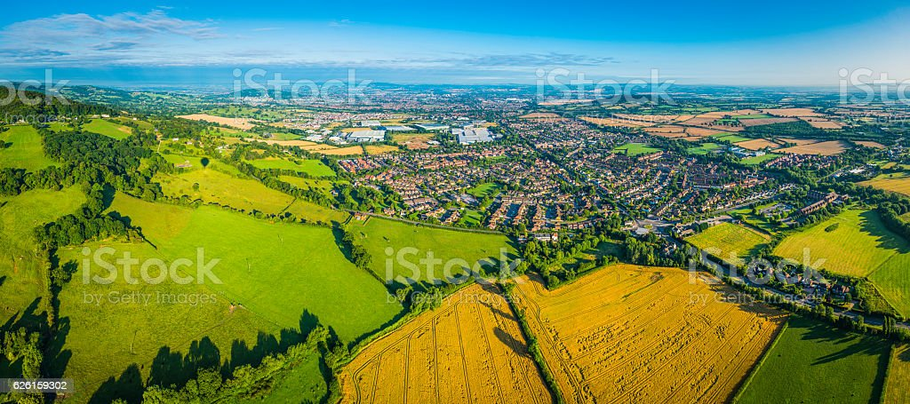 Aerial panorama over summer farmland fields pasture country homes suburbs stock photo