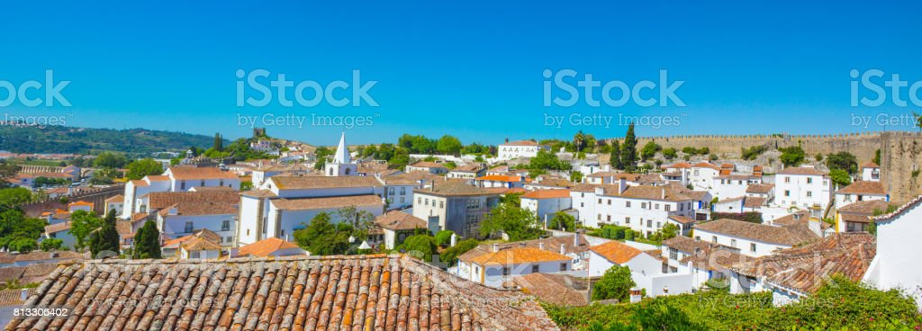Aerial panorama view on the town with medieval houses, wall and  Albarra tower in Obidos portugal famous for tourist. stock photo