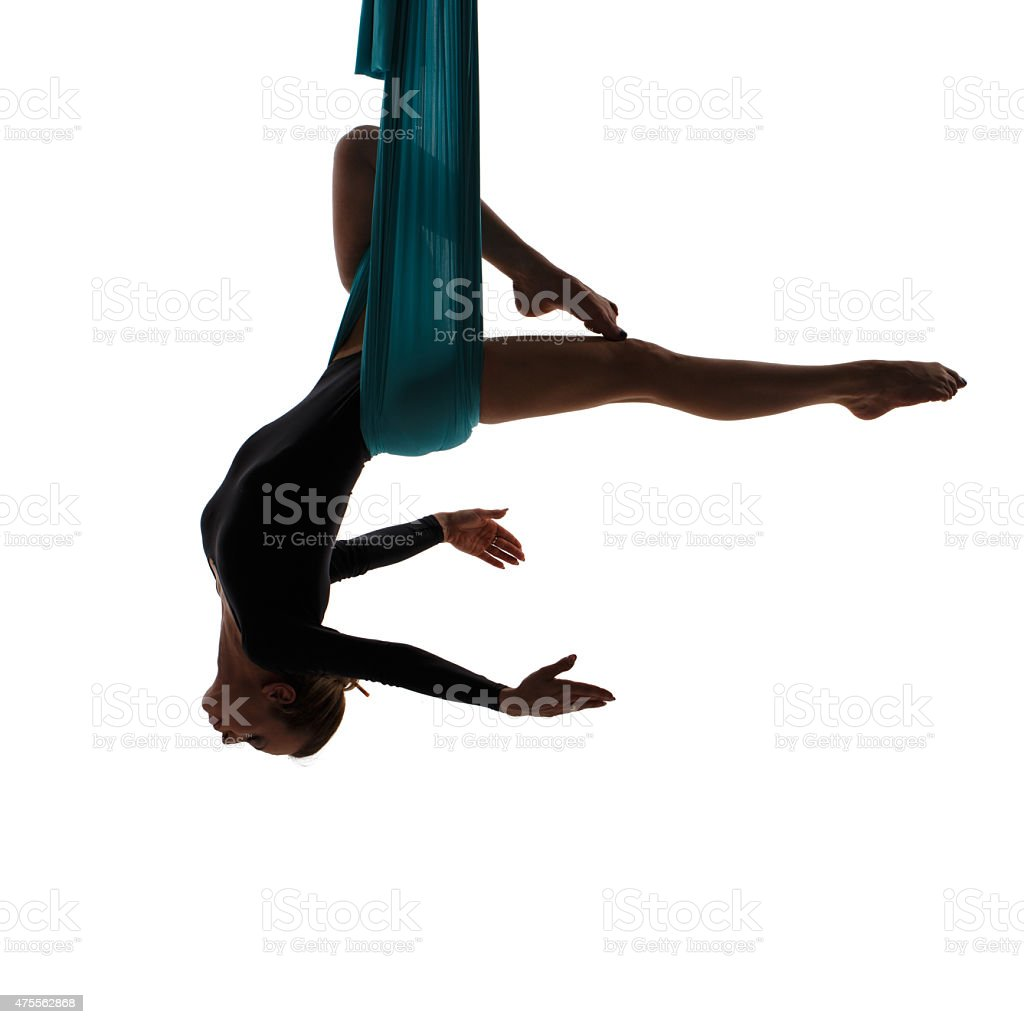 Aerial performer hanging in butterfly pose stock photo