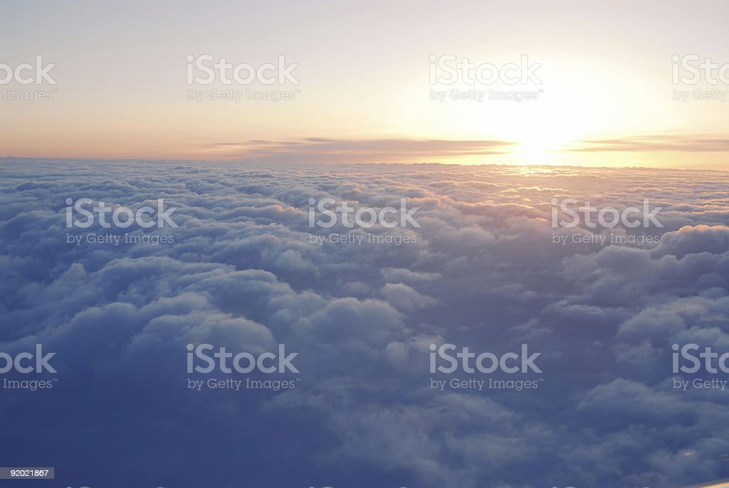 Aerial photo above the clouds of the setting sun stock photo