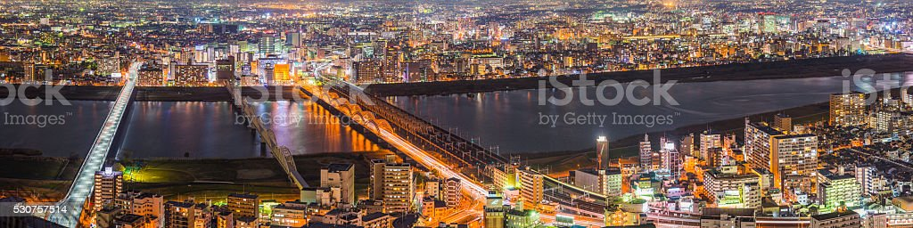 Aerial photo over crowded neon cityscape highrise highways Osaka Japan stock photo