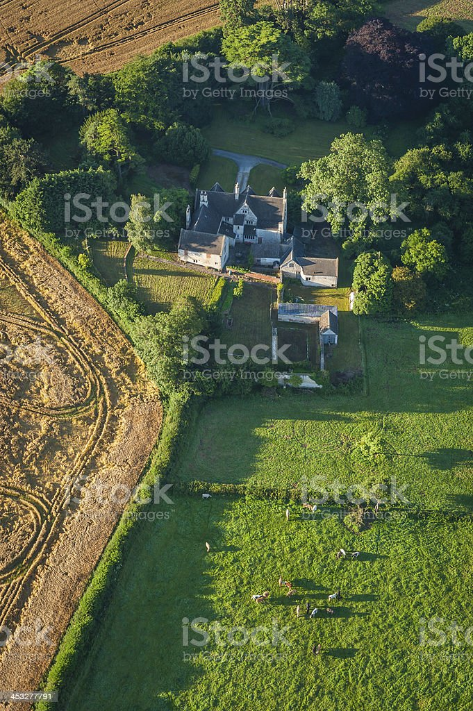 Aerial photo over farm house fields crops idyllic country landscape royalty-free stock photo