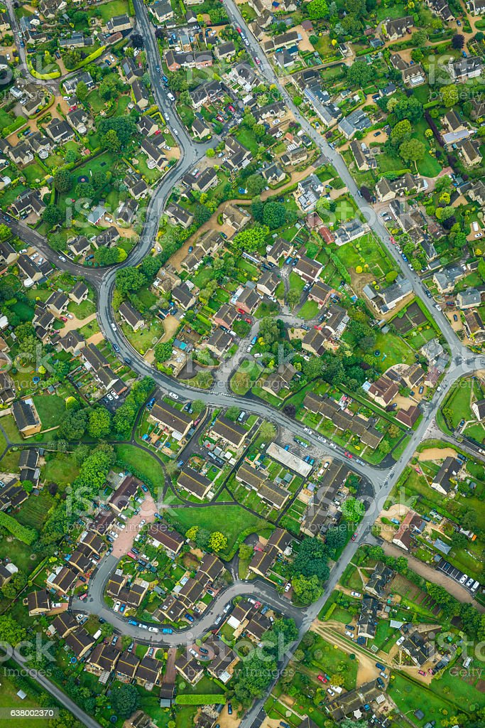 Aerial photo over suburban housing homes roads and green gardens stock photo