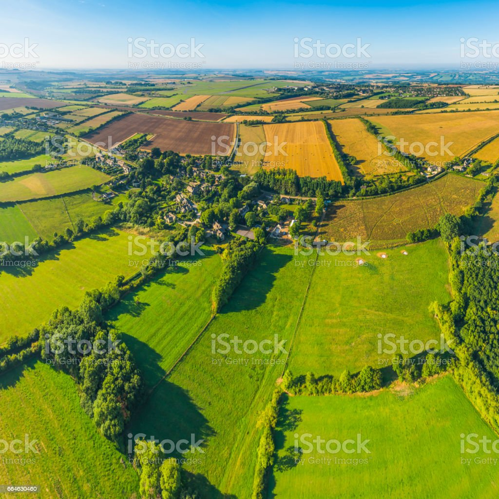 Aerial photograph over green pasture crop fields farms country villages stock photo