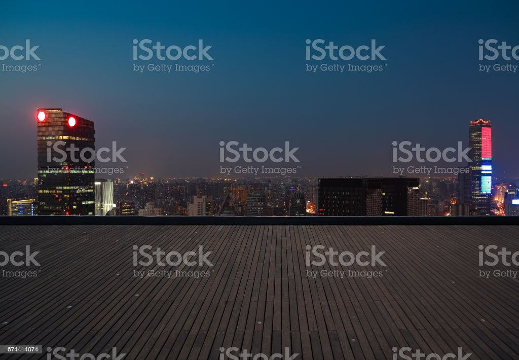 Aerial photography bird view at Empty wood floor with city landmark buildings background at Shanghai Skyline of night scene stock photo