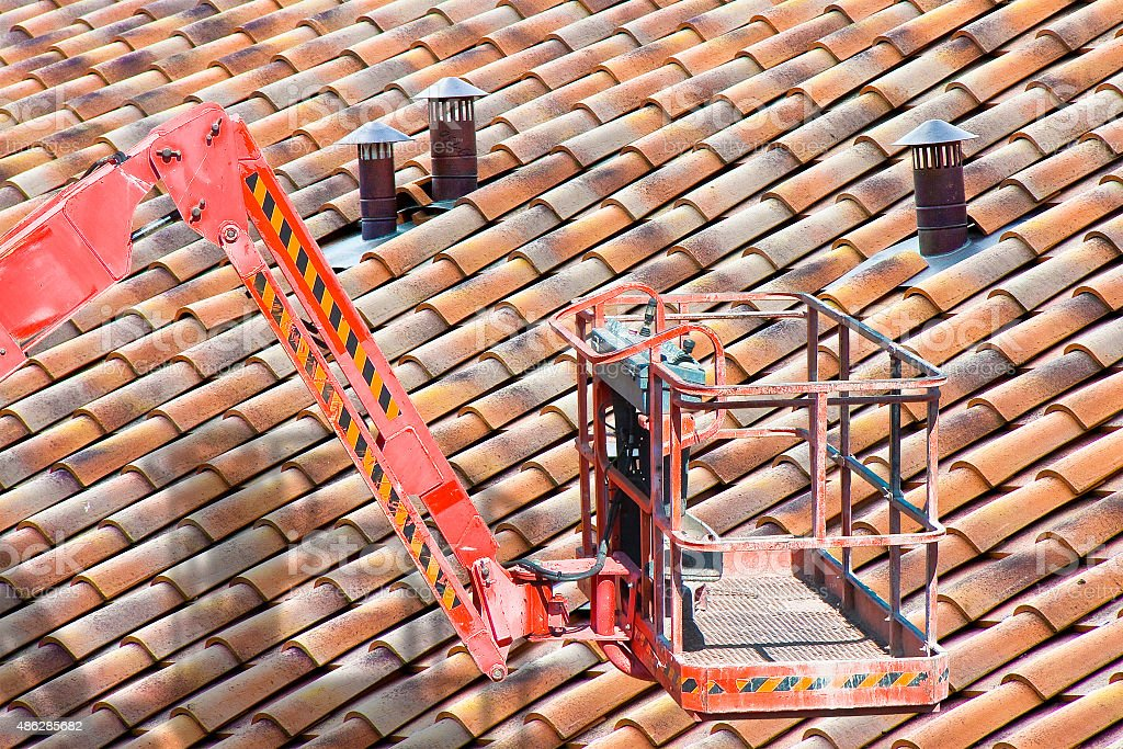 Aerial platform for repairing a roof stock photo