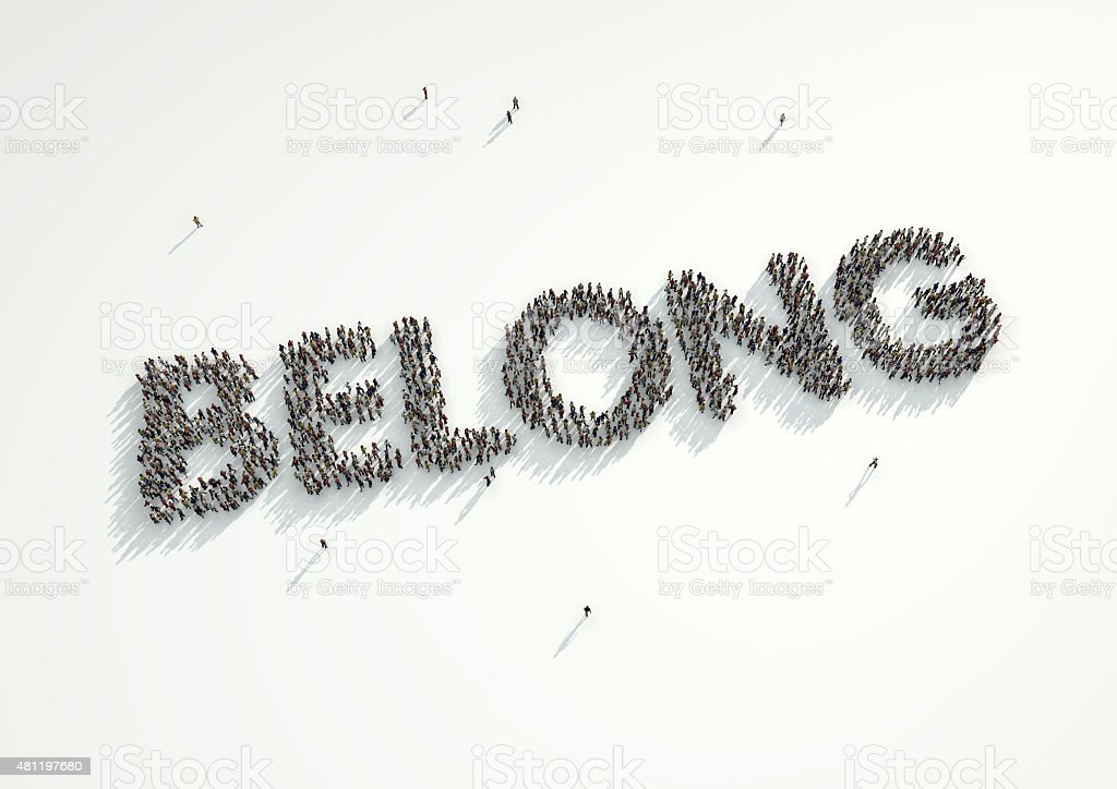 Aerial shot of a crowd forming the word 'Belong'. stock photo