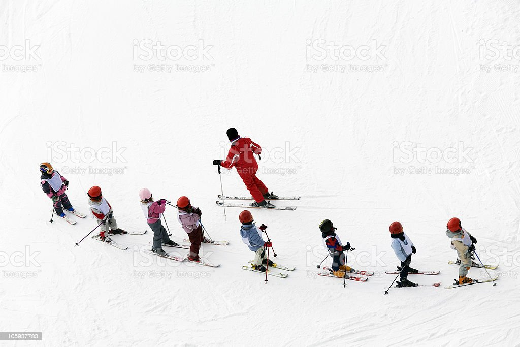 Aerial shot of a group of young skiers and instructor stock photo