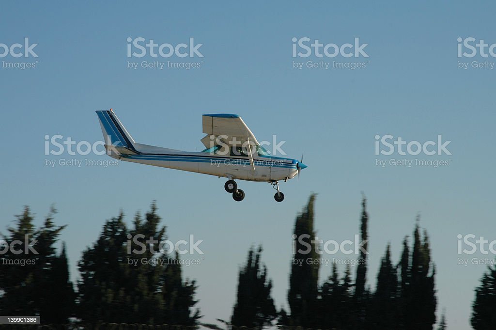 Aerial shot of a landing Cessna in forest stock photo