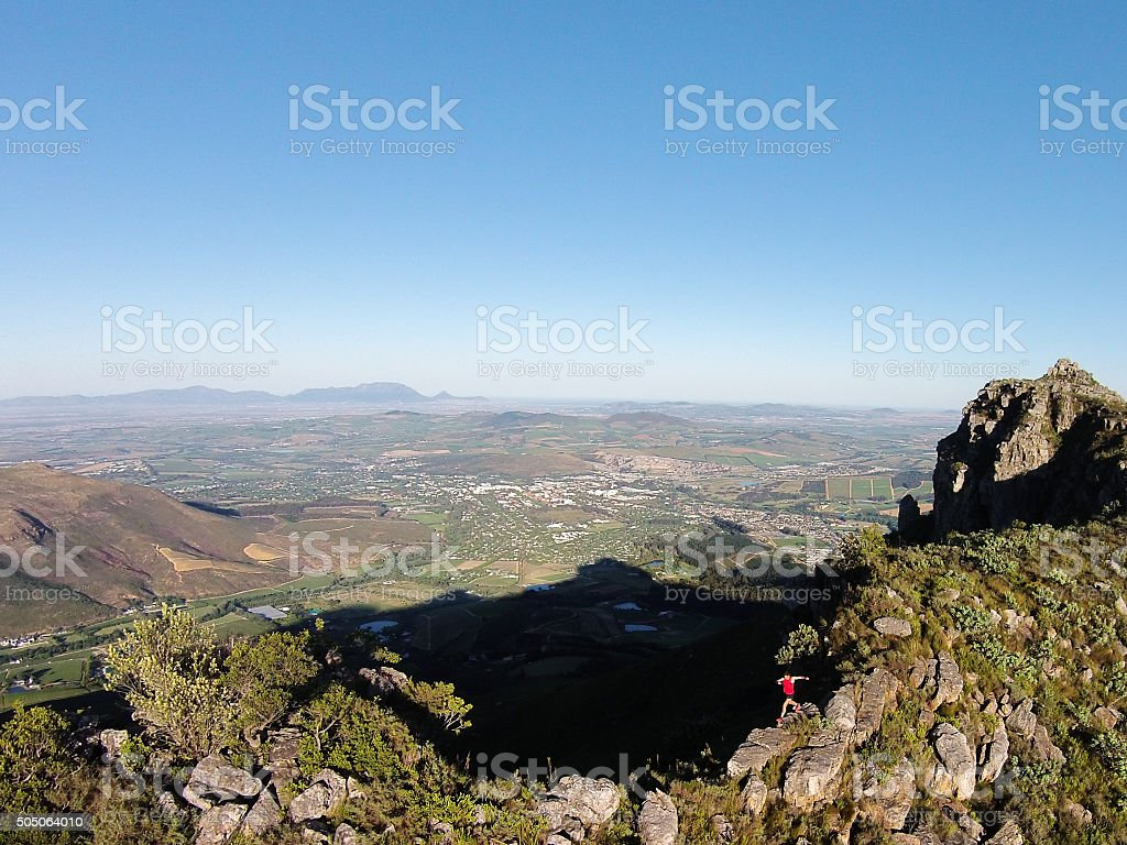 Aerial shot of a male mountain running stock photo