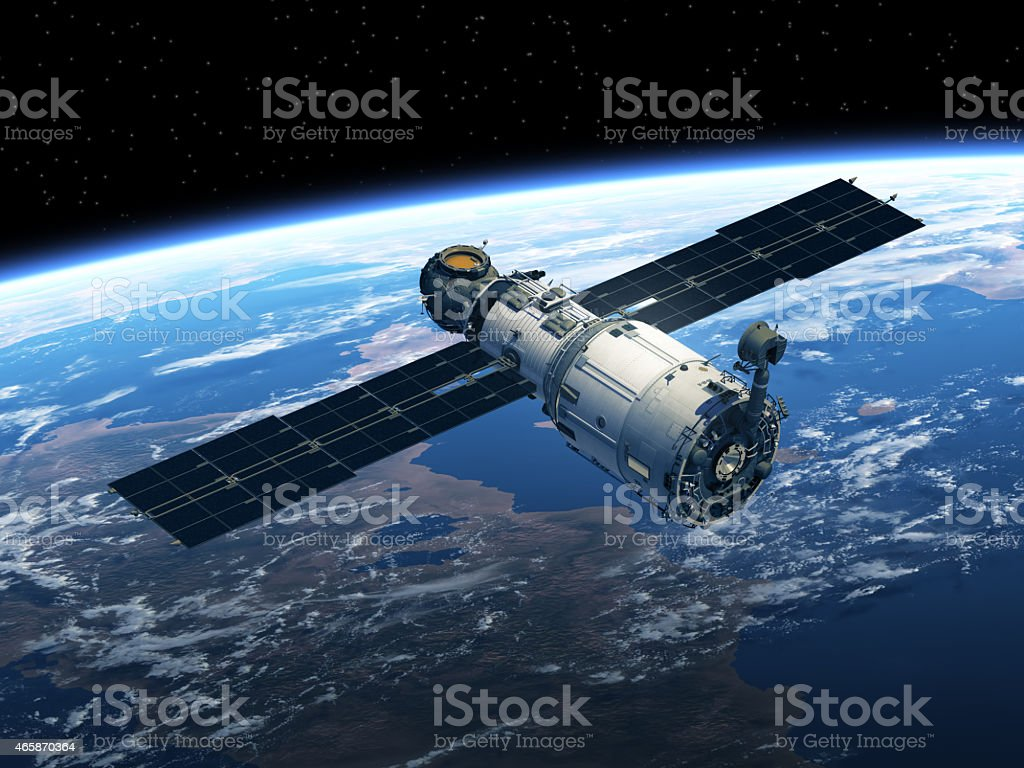 Aerial shot of a space station overlooking the earth stock photo