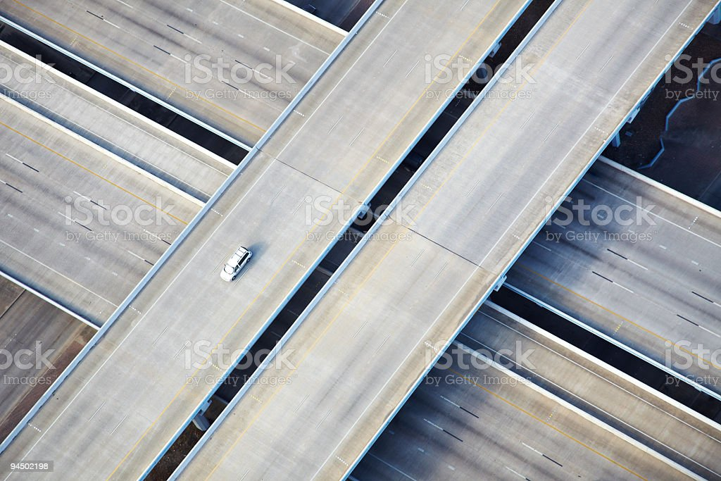 Aerial shot of one car on freeway stock photo