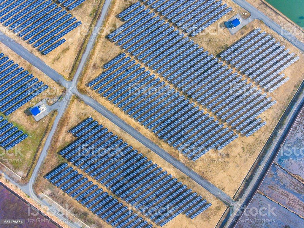 Aerial Shot of Photovoltaics Solar Farm in Rural Area, Overhead stock photo