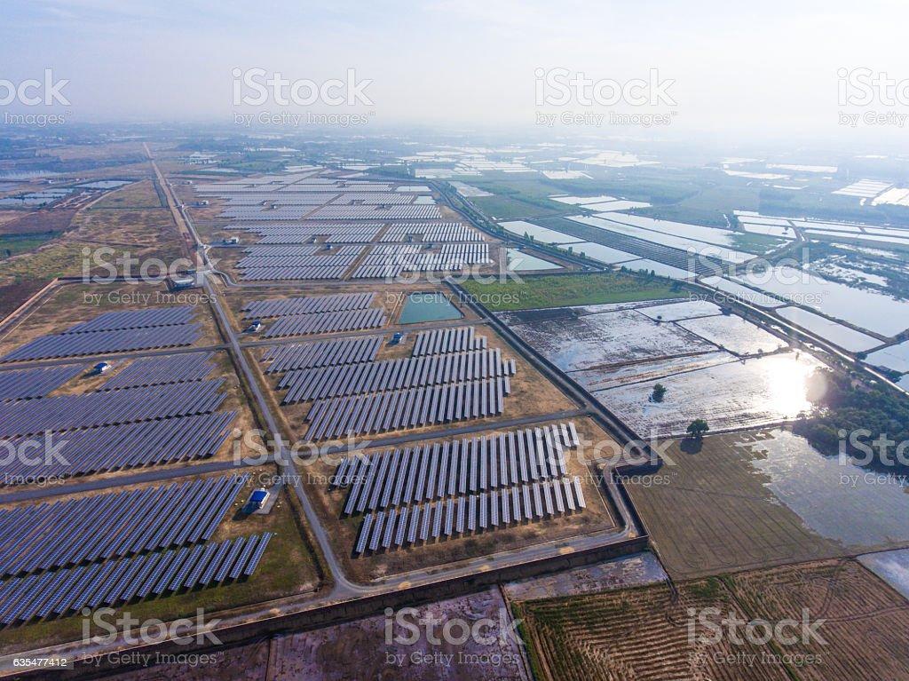 Aerial Shot of Photovoltaics Solar Farm in Rural Area stock photo
