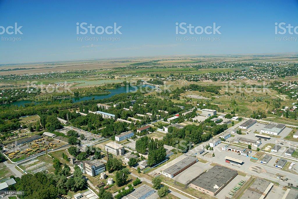 Aerial shot of production facilities with river in the background royalty-free stock photo