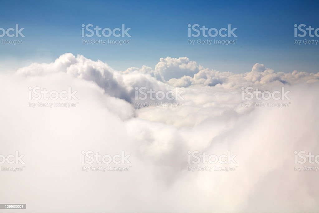 Aerial shot of the sky above some white clouds royalty-free stock photo