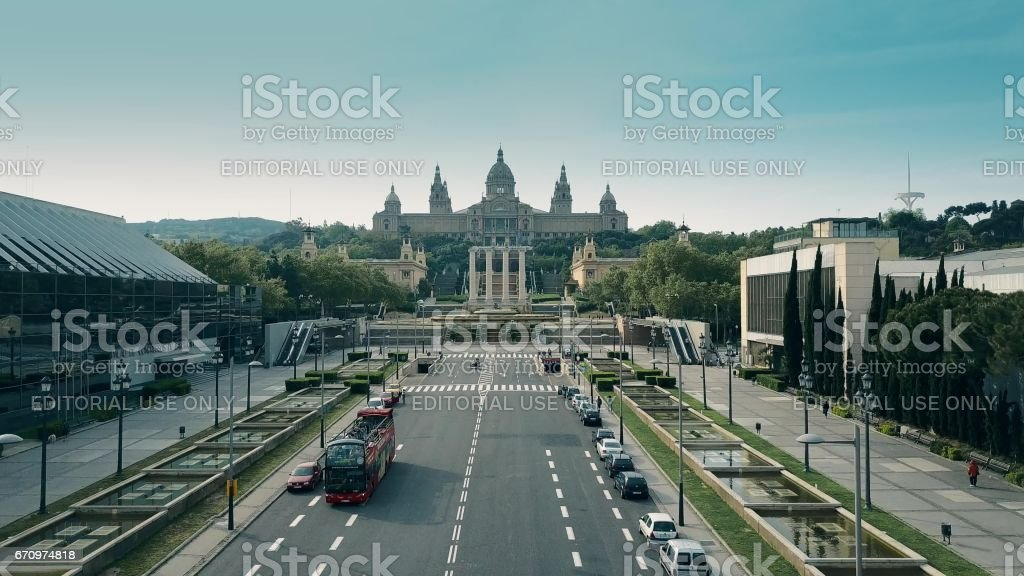 Aerial shot of tour bus and Palau Nacional - National Palace on a sunny day stock photo
