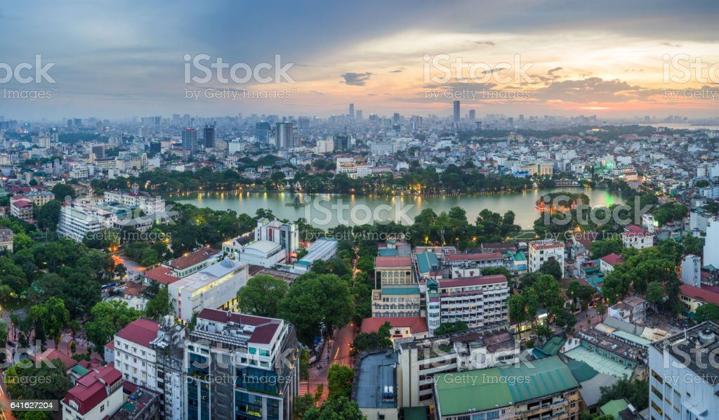 Aerial skyline view of Hoan Kiem lake (Ho Guom, Sword lake) area at twilight. Hoan Kiem is center of Hanoi city. Hanoi cityscape stock photo