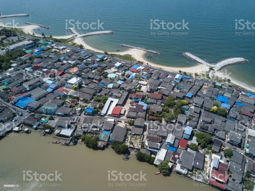 Aerial. Stone wave breaker into the sea at Map ta phut Industrail Estate, Rayong, Thailand stock photo
