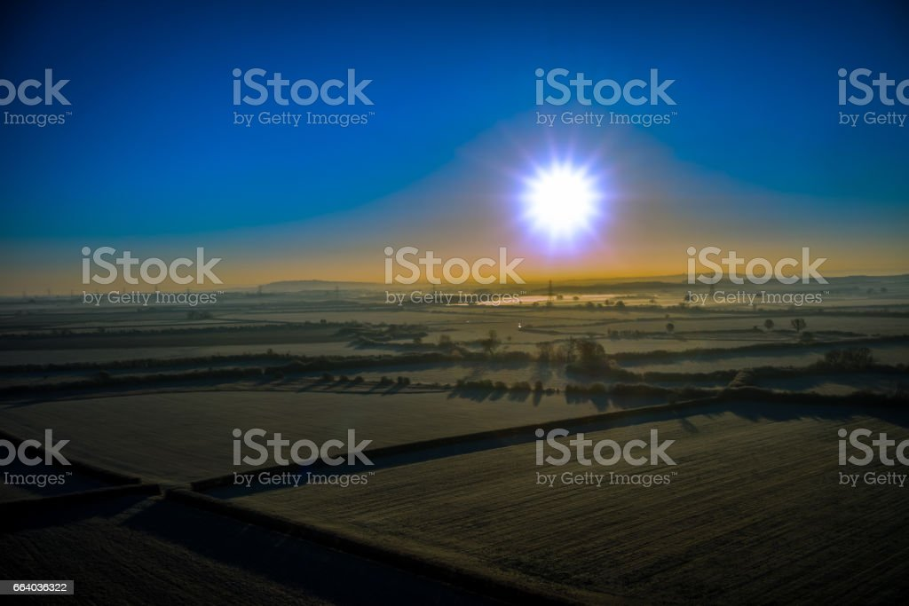 Aerial sun rise over fields stock photo