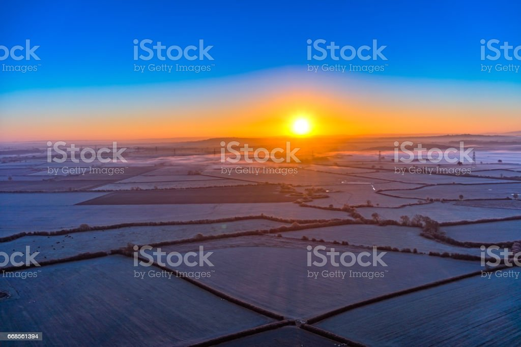 Aerial Sun Rise with Mist and Frost stock photo