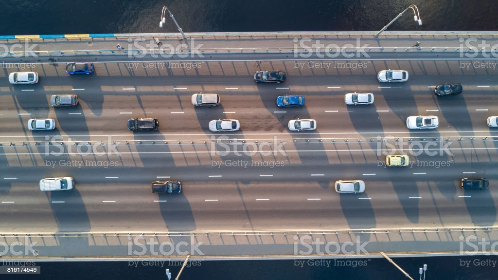 Aerial top view of bridge road automobile traffic of many cars, transportation concept stock photo