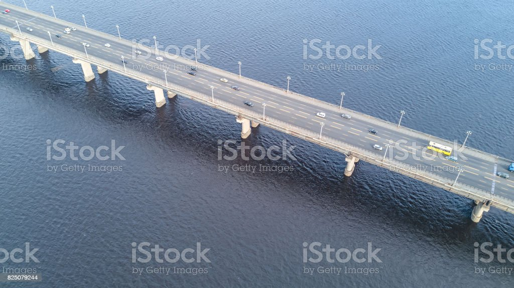 Aerial top view of bridge road automobile traffic of many cars stock photo