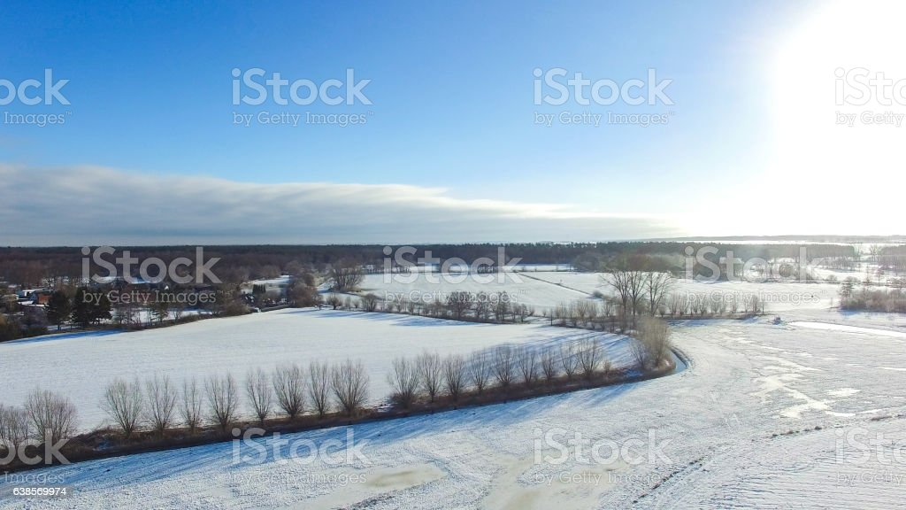 aerial view beautiful snowy landscape with sun and blue sky