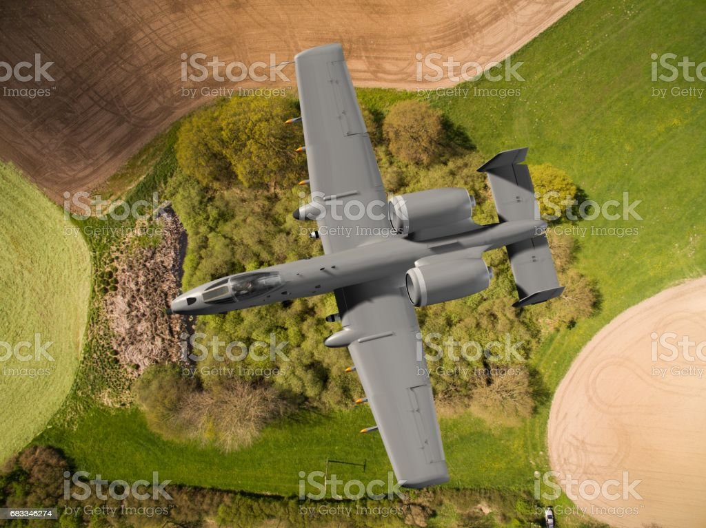 aerial view close up of a  armed US military ground attack aircraft in flight stock photo