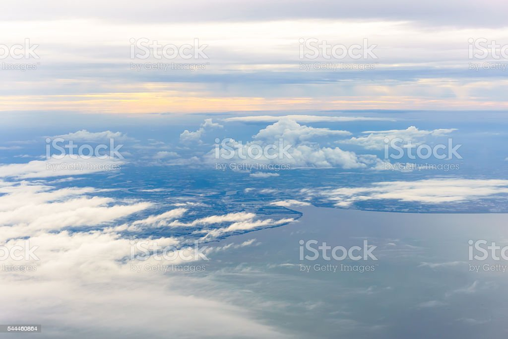 Aerial view from an airplane on a cloudy day. stock photo