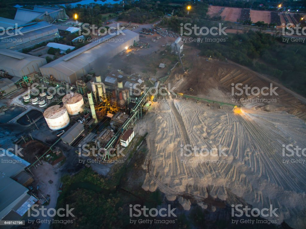aerial view from drone sugar factory at night. stock photo