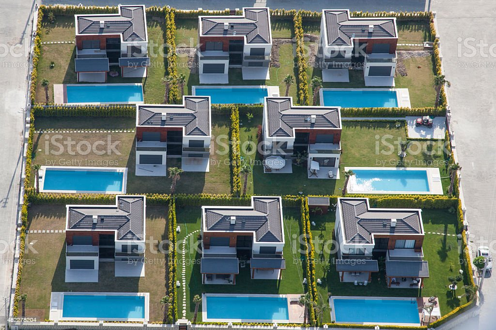 aerial view group of houses with pool stock photo